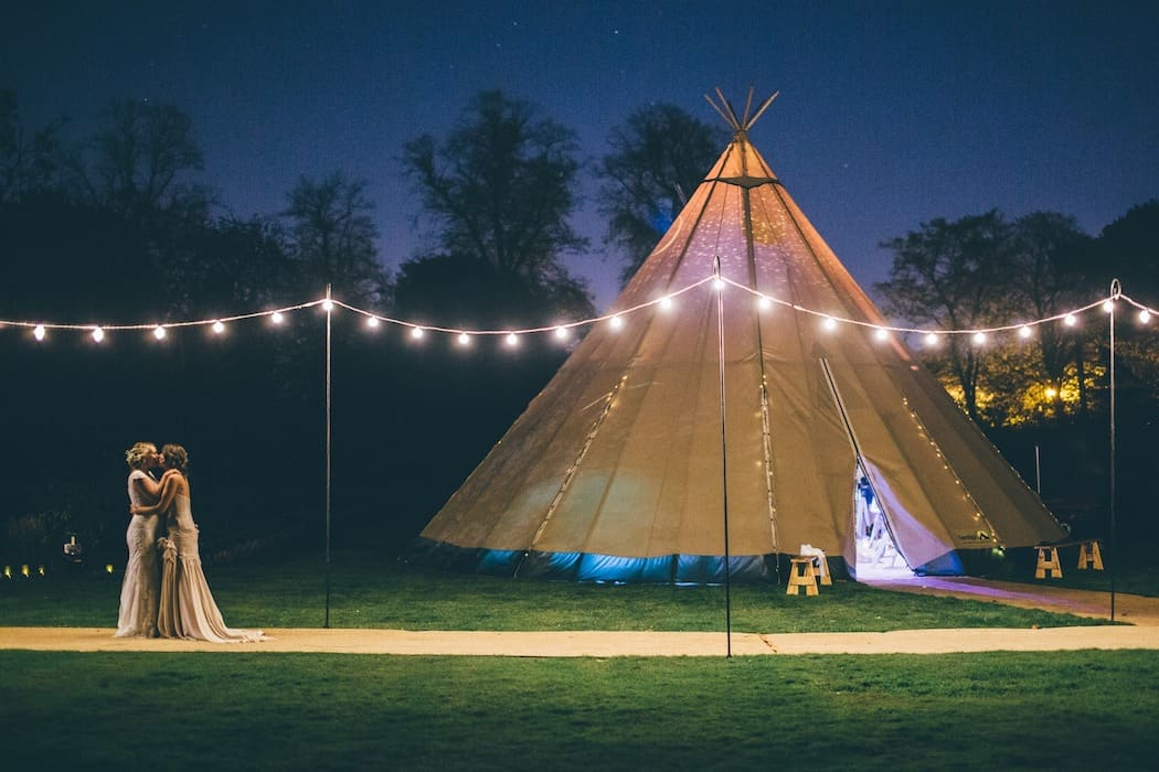 two-brides-festoon-lighting-tipi-wedding