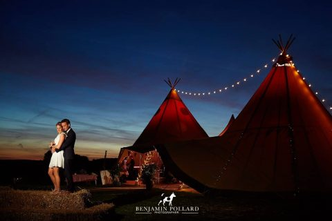 Two giant hat tipis captured at night with our festoon lighting - captured by Ben Pollard Photography