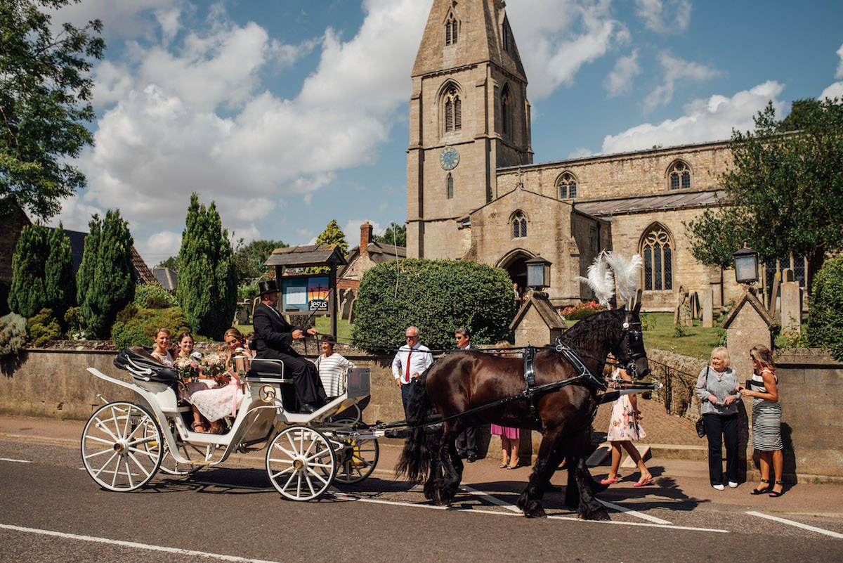 horse and cart arriving at the wedding