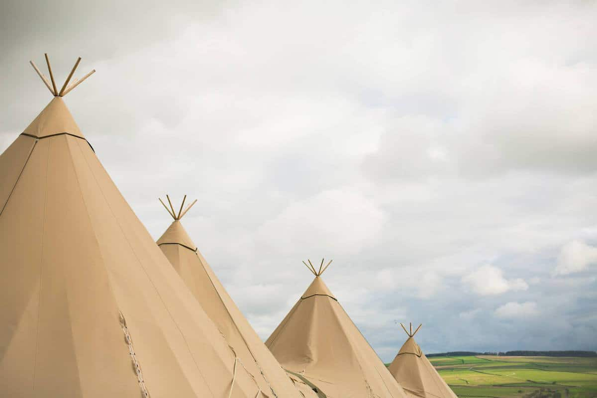 Sami Tipi teepee's all in a row at Peak District Farm Weddings