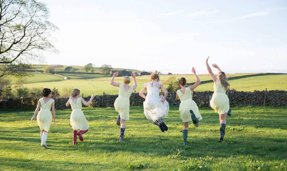Peak District Farm Sami Tipi Wedding Bridal Party in Wellingtons