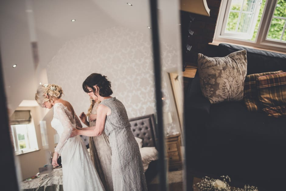 Sami Tipi Wedding - Bride Getting Ready captured by Amy Shore Photography