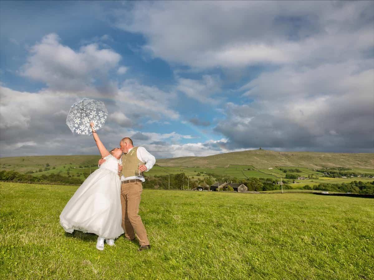 Outdoor Wedding Fun with umbrella