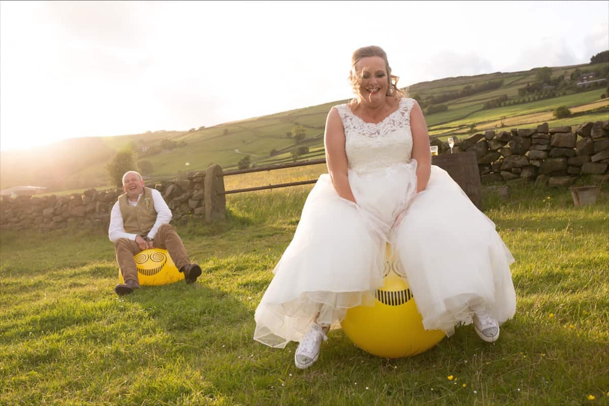 Outdoor Wedding Fun with space hoppers