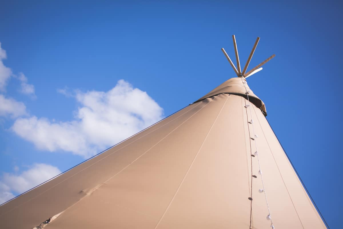 the peak of two giant hat tipis