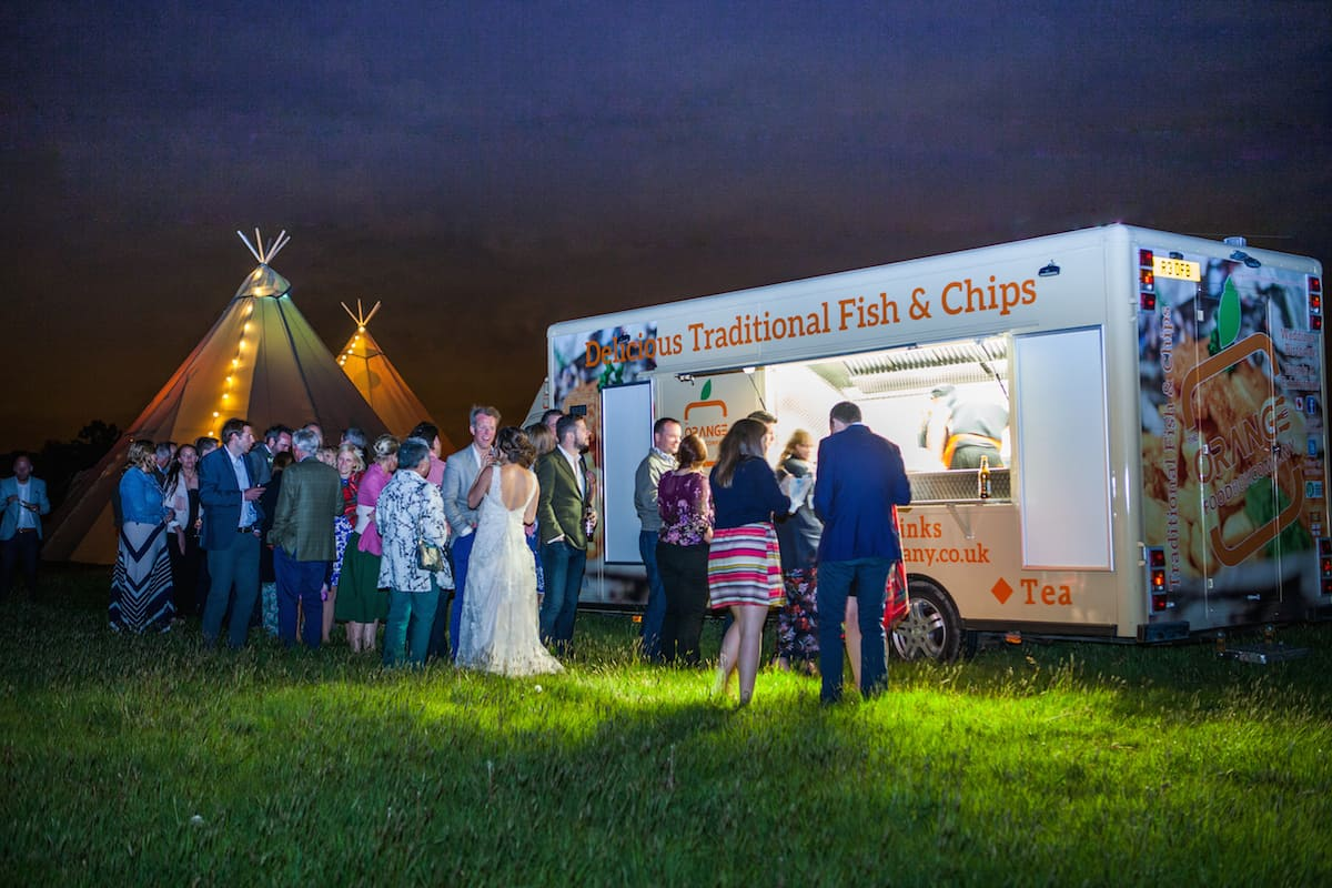relaxed wedding food - traditional fish and chips at a sami tipi wedding