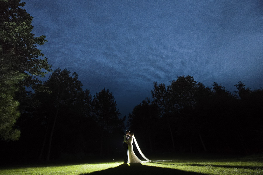Night shot of bride and groom at their Bodenham Arboretum Tipi Wedding Celebration