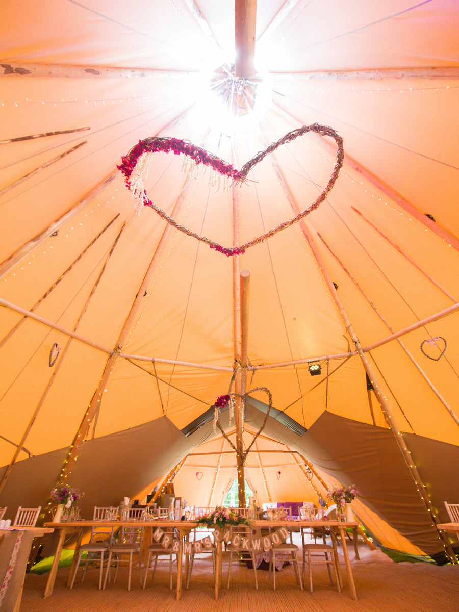 Hanging floral hoop in Bodenham Arboretum Teepee Wedding by Sami tipi
