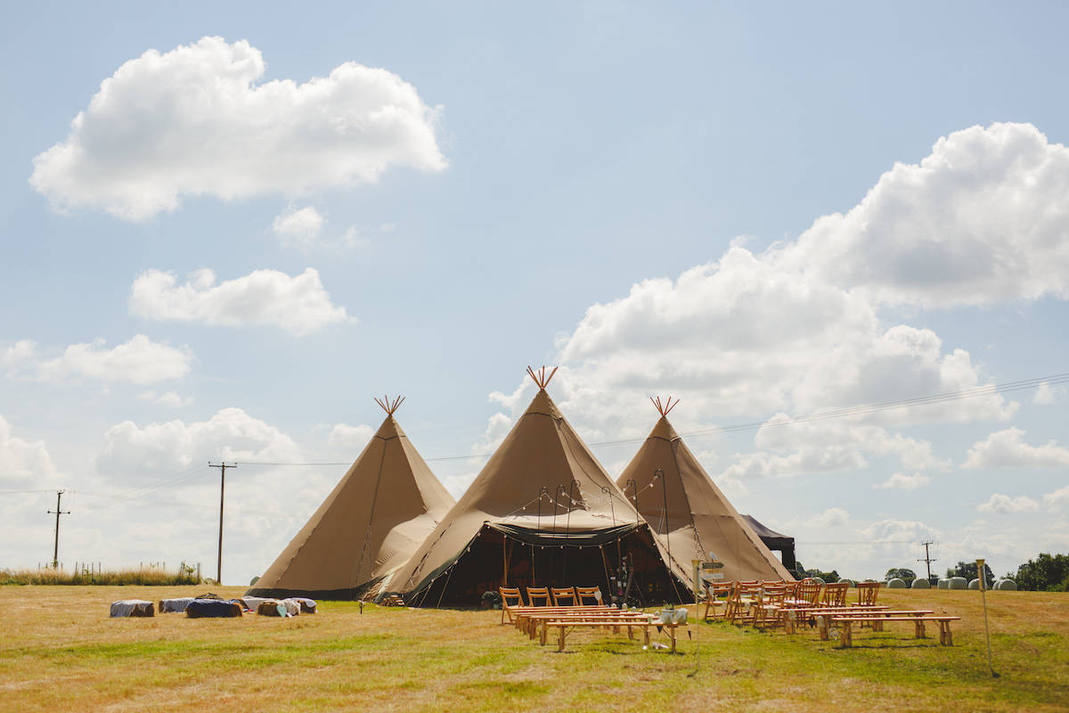 Three giant hat tipis with outdoor ceremony - Sami Tipi Wedding Captured by Camera Hannah