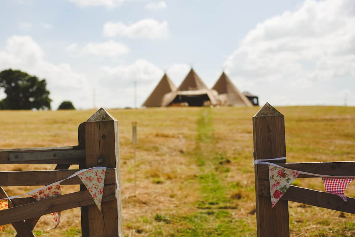Gated Field Entrance leading to Three Giant Hat Tipis