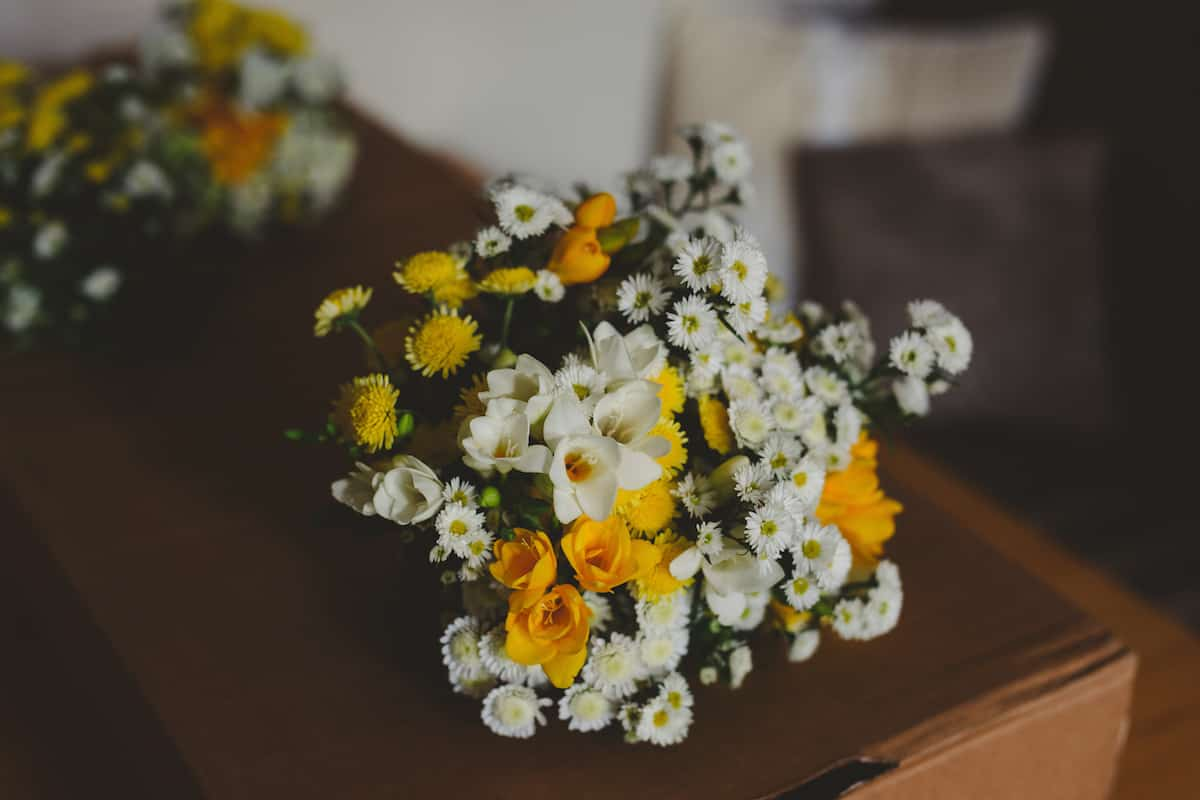 Yellow and White Flowers Team Yellow Gay Wedding Ideas for Two Brides