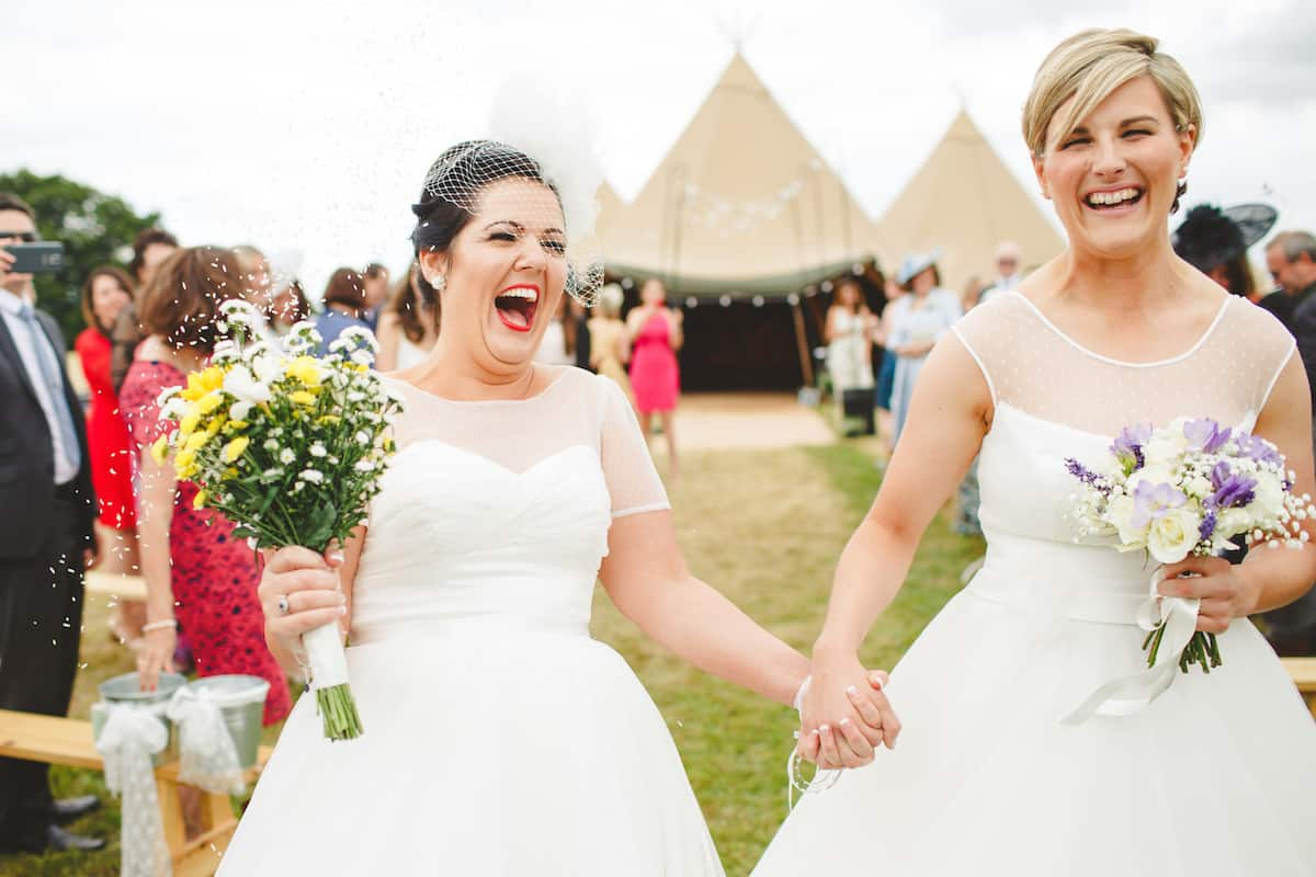 two brides outdoor wedding ceremony - Sami Tipi Wedding Captured by Camera Hannah