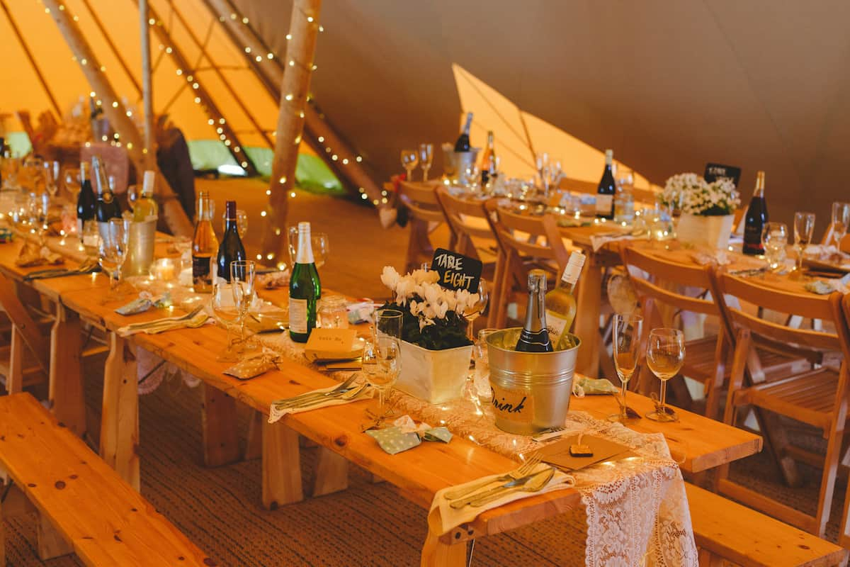 Table setup in three giant hat tipis