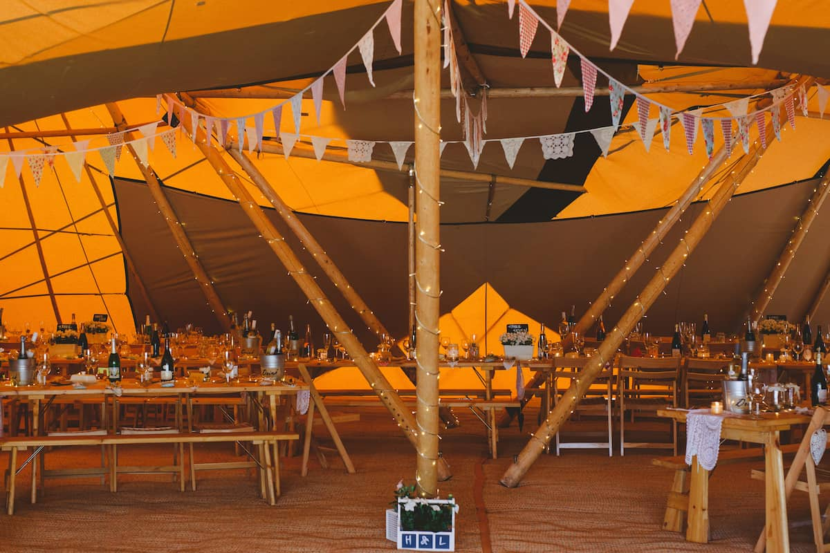 Three Giant hats in a triangle table setup