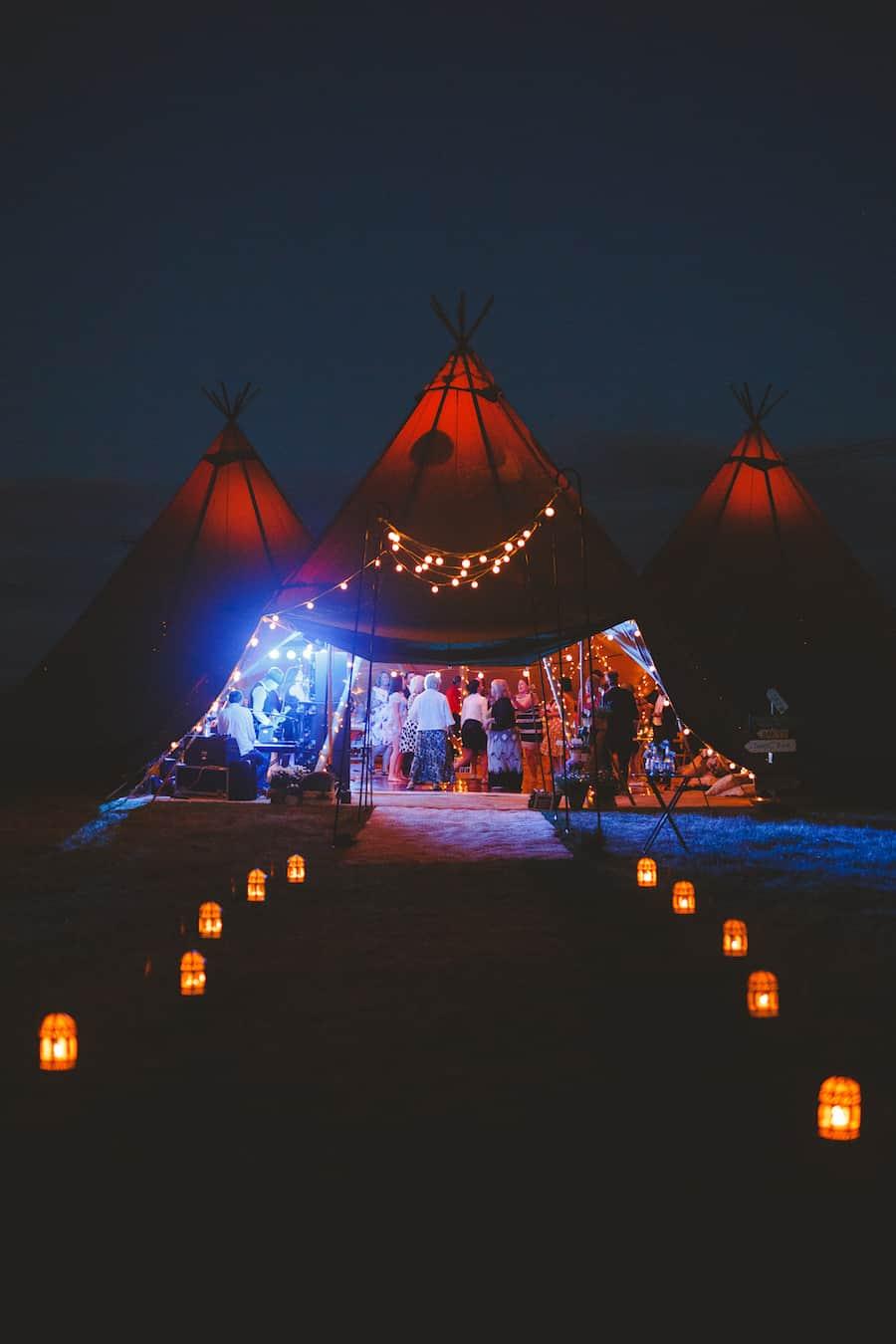 Tipi Walkway at night with lanterns and festoon walkway - Tipis glowing
