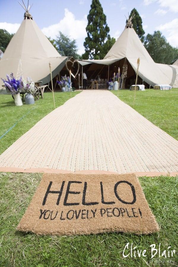Hello You Lovley People Tipi Entrance - Sami Tipi Wedding captured by Clive Blair