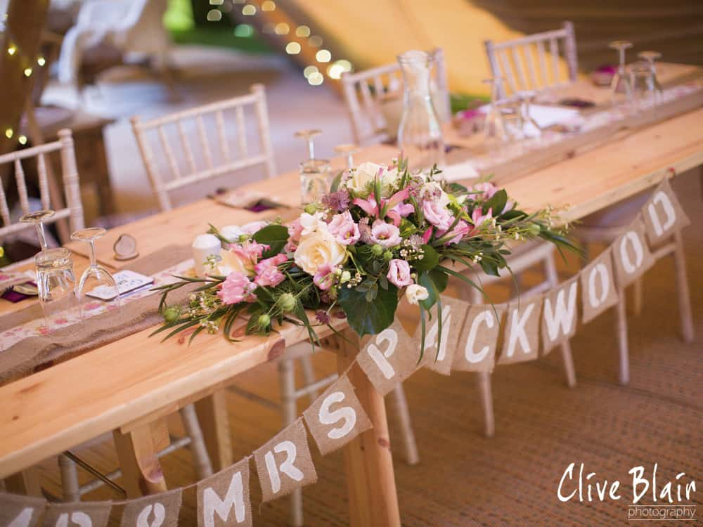 Top Table and Floral display - Sami Tipi Wedding captured by Clive Blair