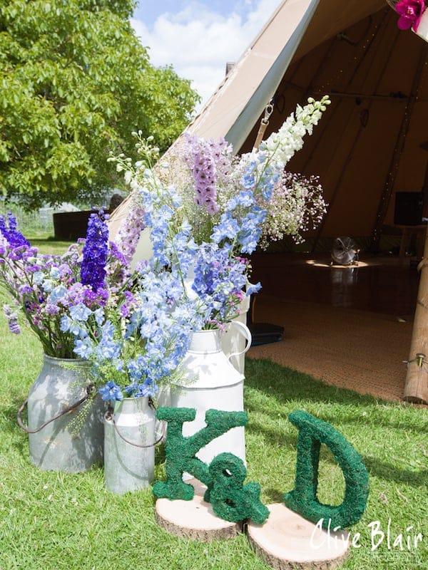 Floral Entrance Display to tipis - Sami Tipi Wedding captured by Clive Blair