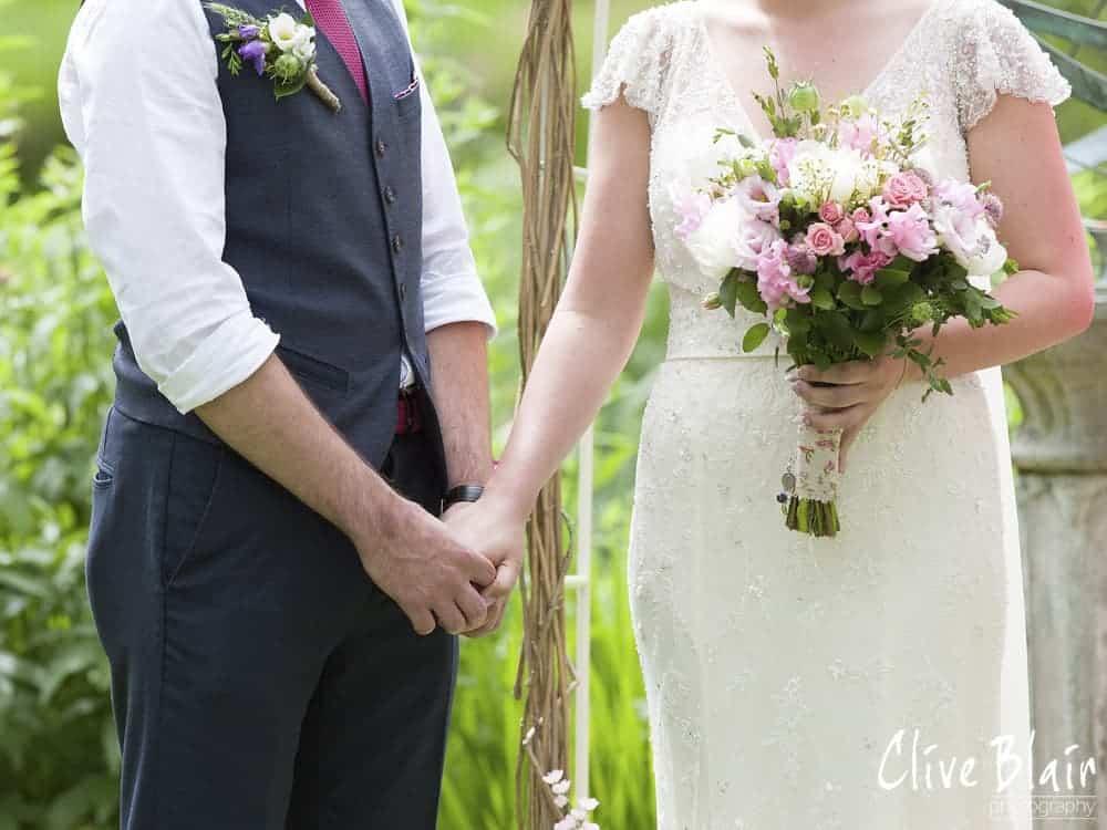 Outdoor ceremony- Sami Tipi Wedding captured by Clive Blair