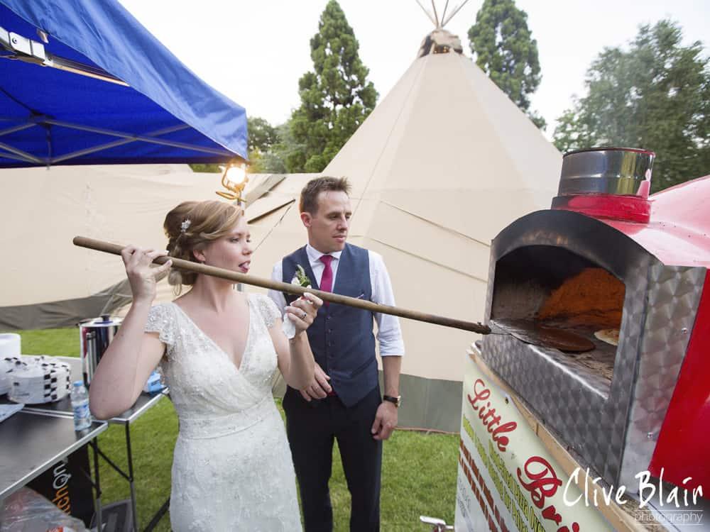 Couple Photos Pizza Oven- Sami Tipi Wedding captured by Clive Blair