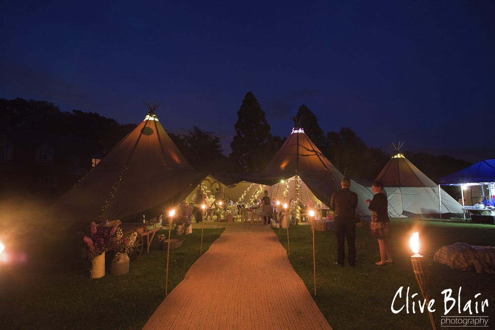 Tipis by night - Sami Tipi Wedding captured by Clive Blair