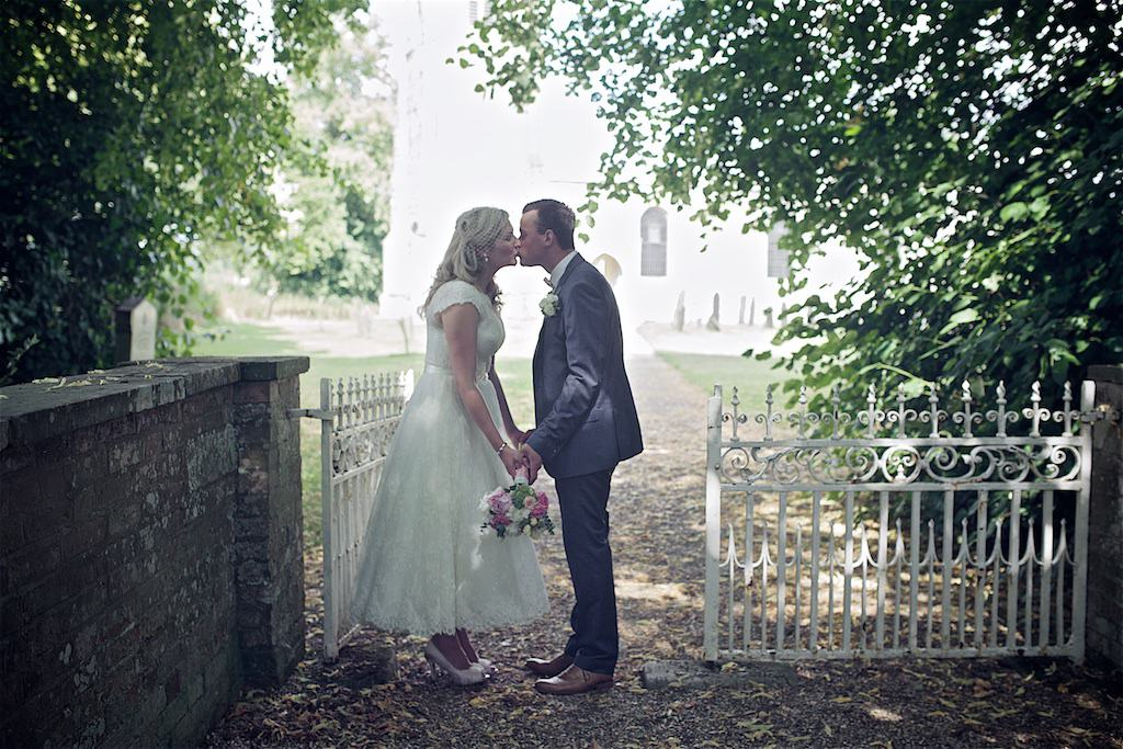 Married kiss at the gate - Sami Tipi Wedding captured by Shoot it Momma