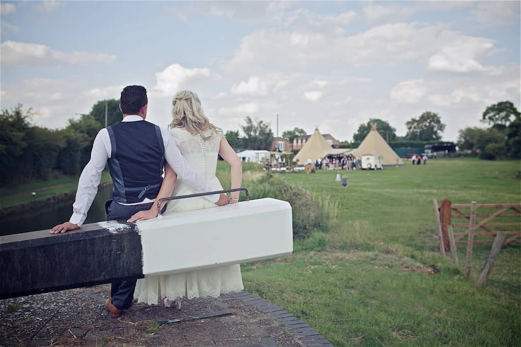 Taking a moment to enjoy the day together - Sami Tipi Wedding captured by Shoot it Momma