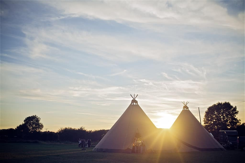 Two giant hat tipis at sun set- Sami Tipi Wedding captured by Shoot it Momma