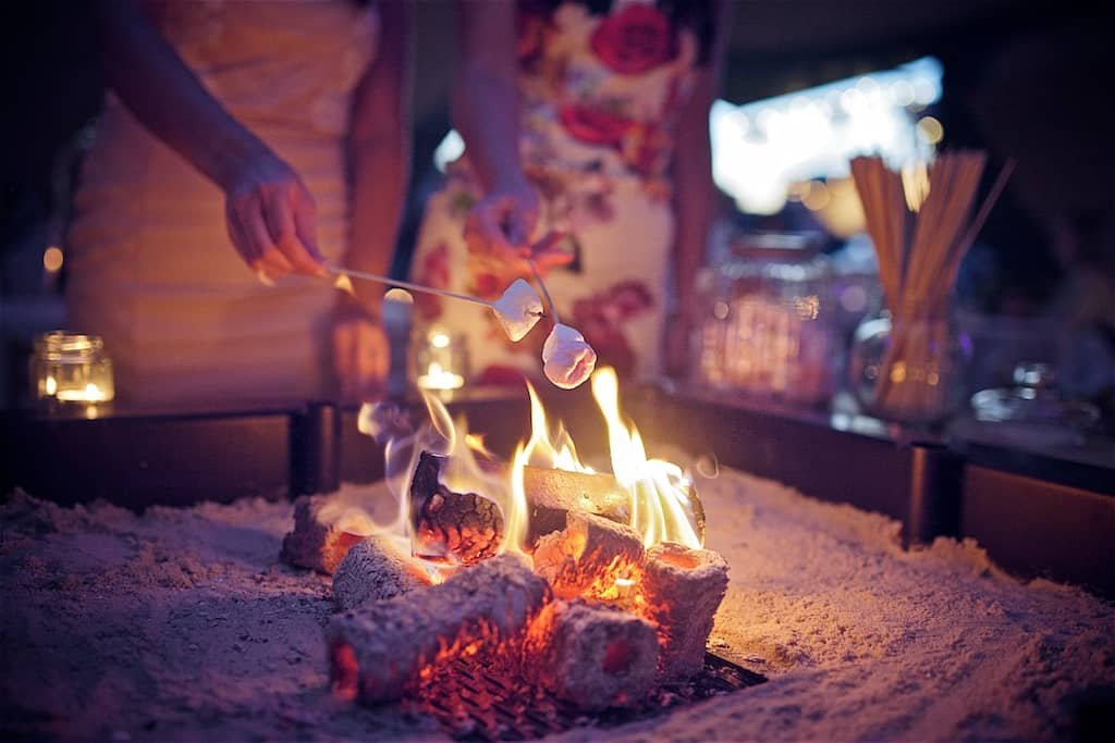 Evening Fire Toasting Marsh Mellows Sami Tipi Wedding captured by Shoot it Momma