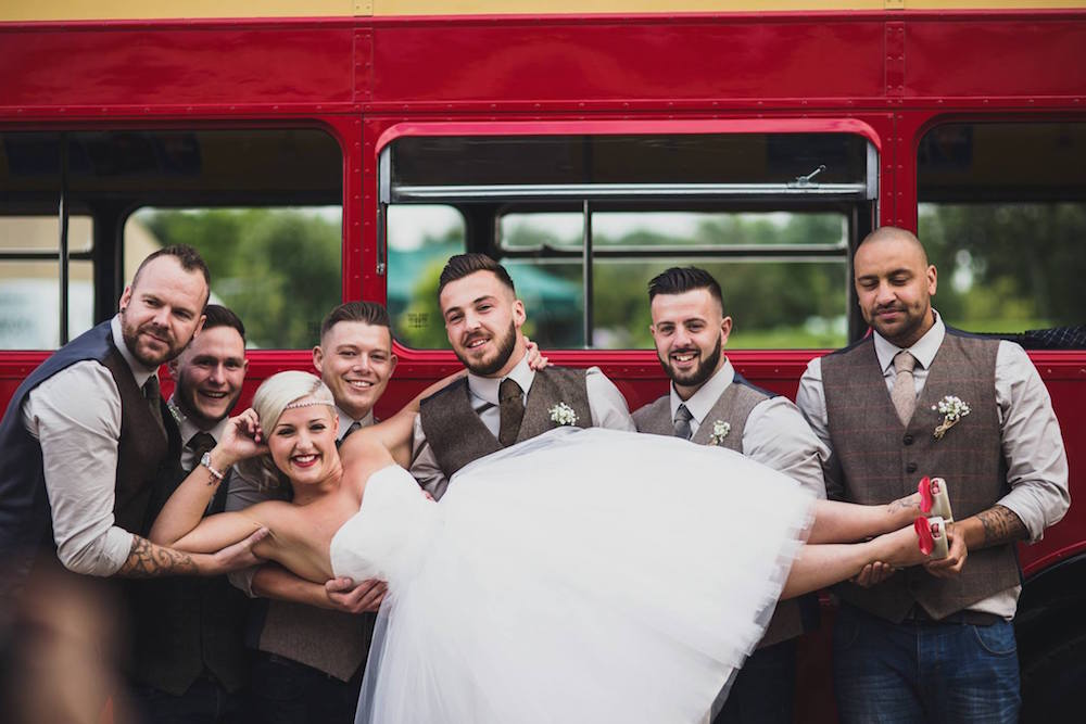 dani and jords enjoying a few moments together in front of the Big Red Bus - Sami Tipi Wedding at Bawdon Lodge Farm