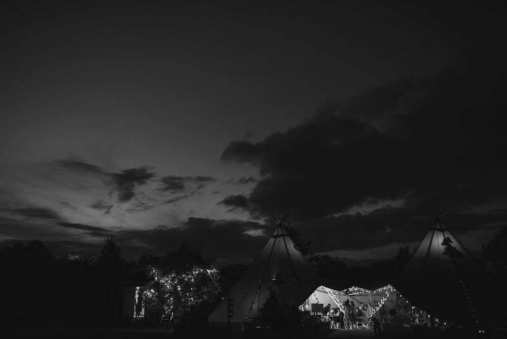 tipis at night - Sami Tipi Wedding at Bawdon Lodge Farm