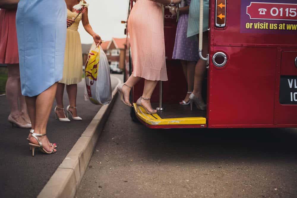girls getting on the bus - Sami Tipi Wedding at Bawdon Lodge Farm