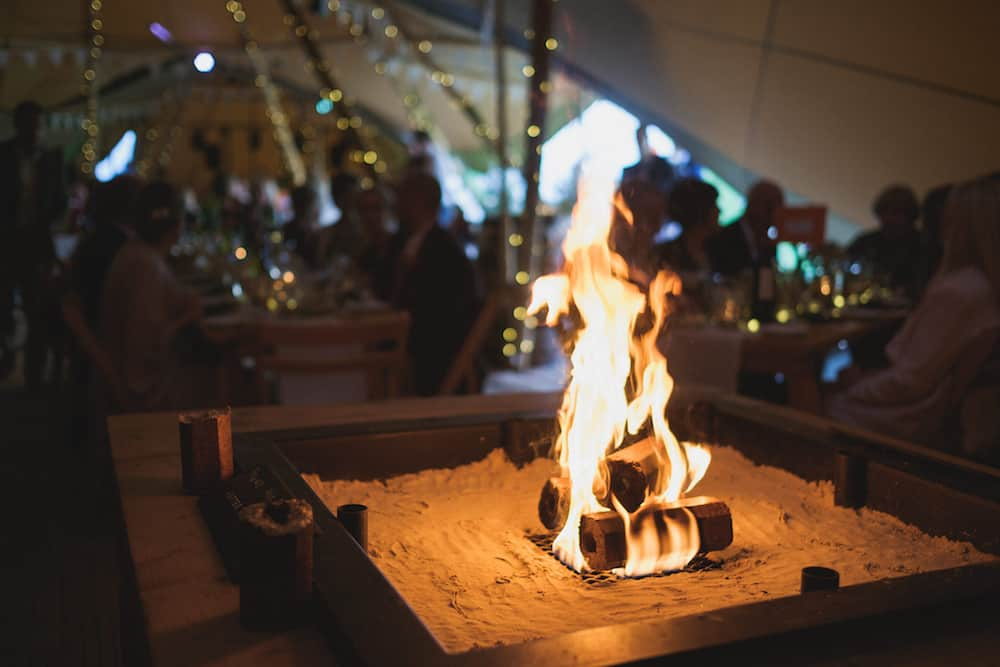 open fireplace - Sami Tipi Wedding - Captured by Duncan Cox