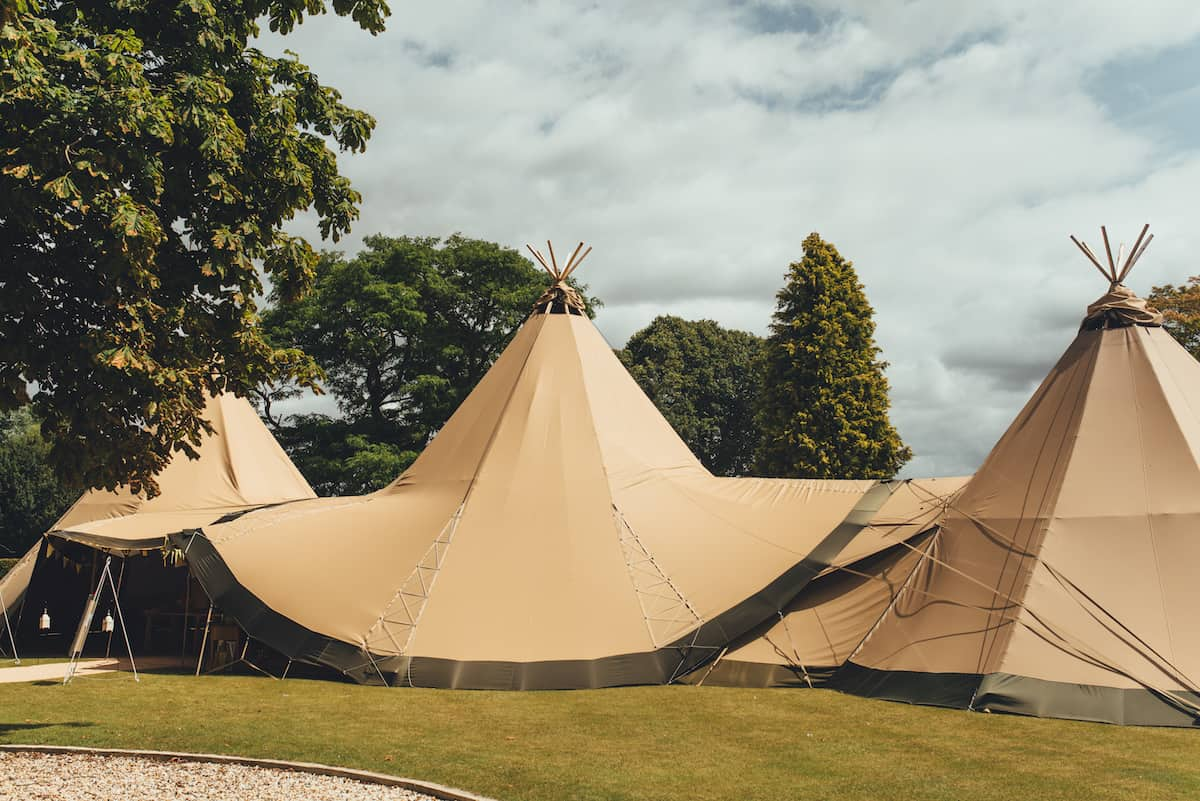 Two giant hat tipis and chill-out tipi - Sami Tipi Wedding Hire captured by Becky Ryan