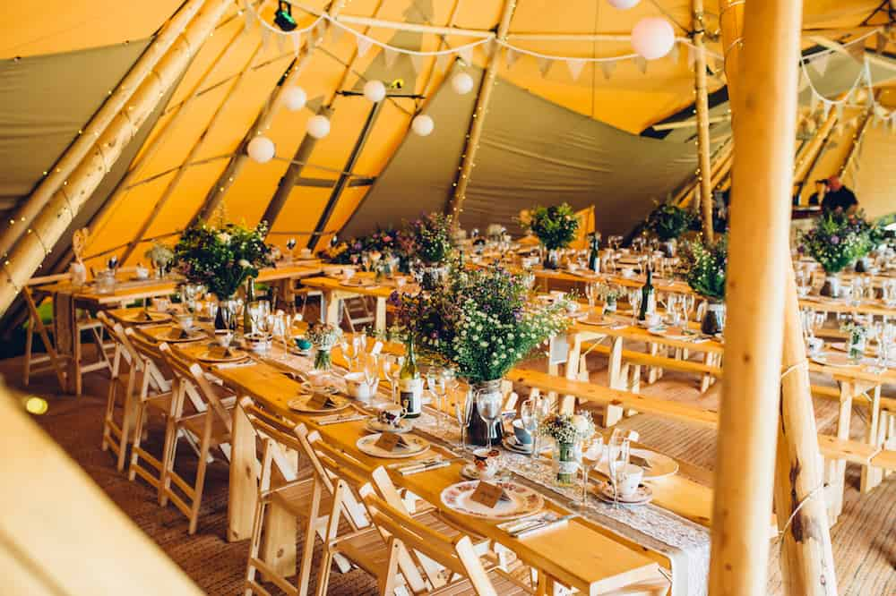 Tipi Interior of three giant hat tipis - Sami Tipi Derbyshire Wedding - captured by Matt Brown Photography