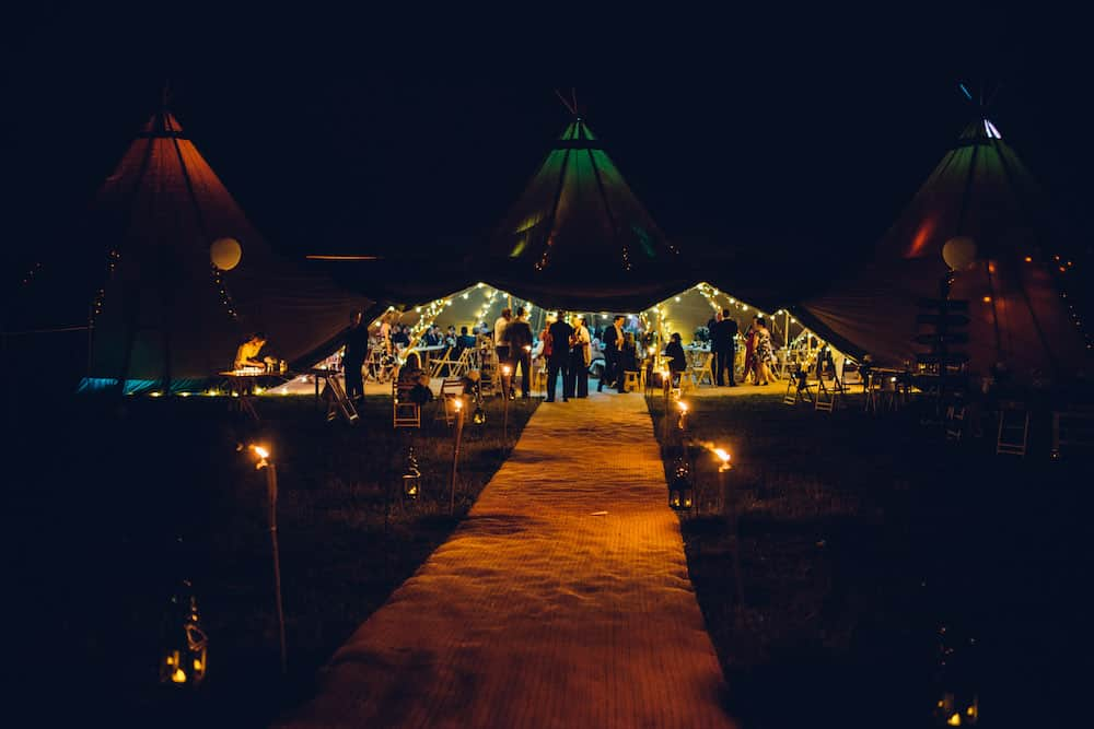 Tipis by night - Sami Tipi Derbyshire Wedding - captured by Matt Brown Photography
