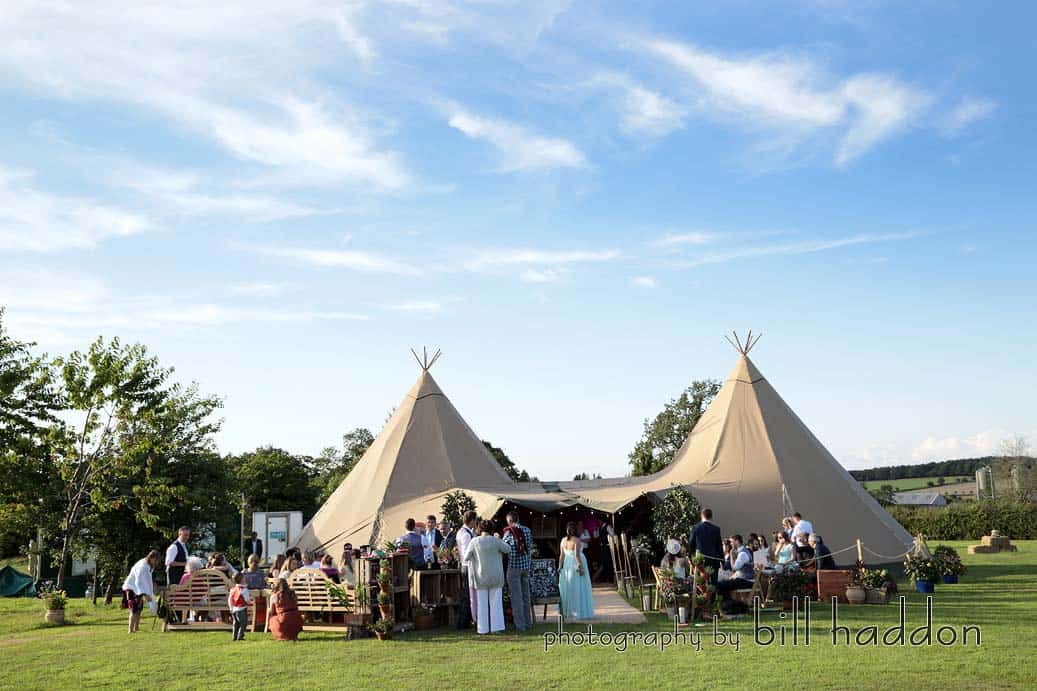 Two Giant Hat Tipis Summer Wedding - Sami Tipi Wedding by Bill Haddon Photography -