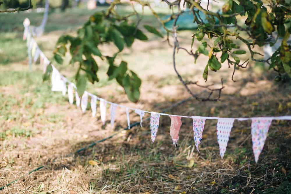 Rustic Bunting - perfect compliment to a relaxed outdoor wedding. Image by Kathryn Edwards