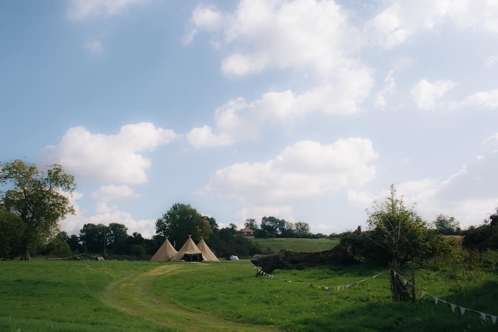 Three giant hat tipis Leicestershire - Sami Tipi Wedding - Image by Kathryn Edwards