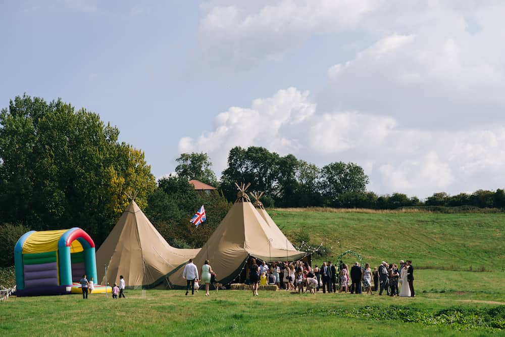 Three giant hat tipis - Sami Tipi Wedding - Image by Kathryn Edwards