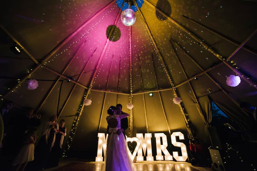 tipis at night first dance - Sami Tipi Wedding - Image by Kathryn Edwards