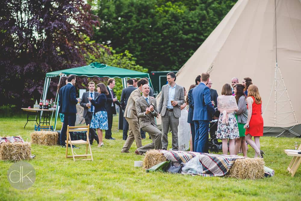 Relaxed tipi fun - Sami Tipi Wedding in Buckinghamshire - Captured by DK Wedding Photography