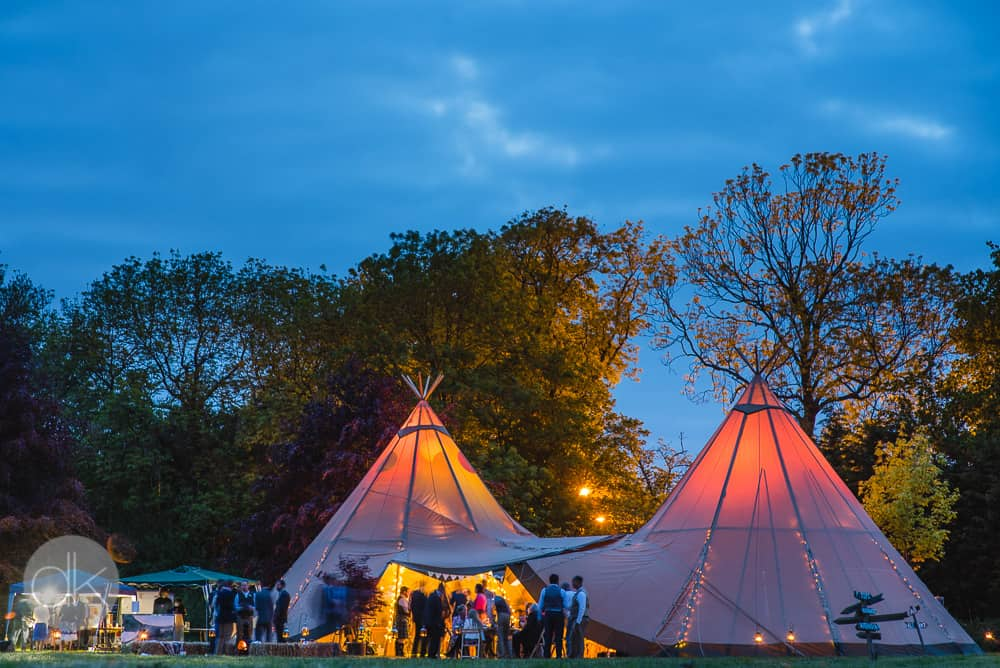 Two giant hat tipis at dusk - Sami Tipi Wedding in Buckinghamshire - Captured by DK Wedding Photography