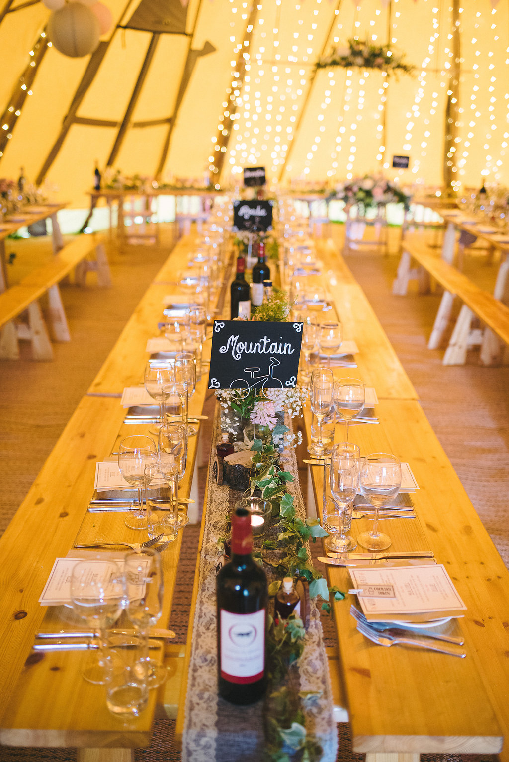 Long Tipi Tables with Rustic Setting