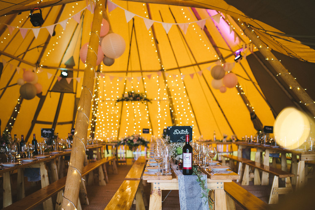 Fairy lights and rustic Styled Spring Tipi Wedding Celebration