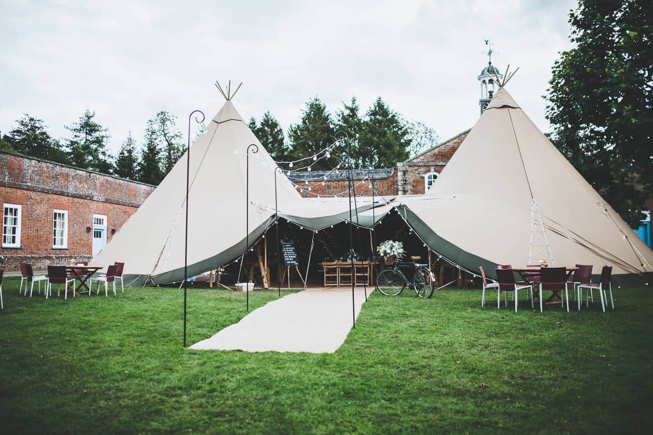 Two giant hat tipis - Sami Tipi wedding by Frankee Victoria