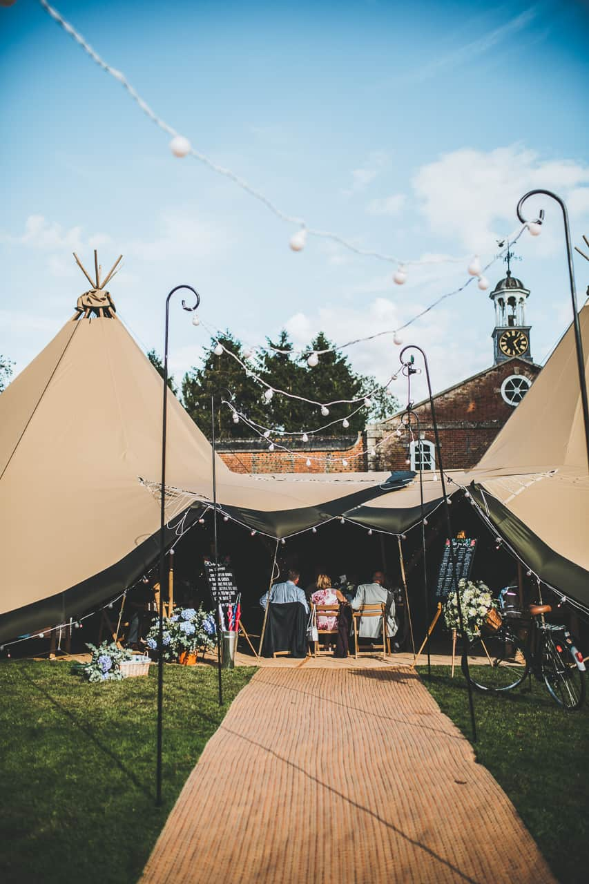 Two giant hat tipi set up Claydon House - Sami Tipi wedding by Frankee Victoria