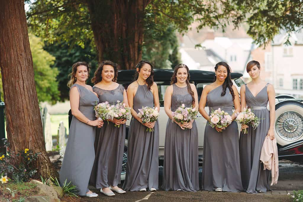 Grey bridesmaid dresses - Arriving at church - Sami Tipi Wedding by london-weddingphotographer