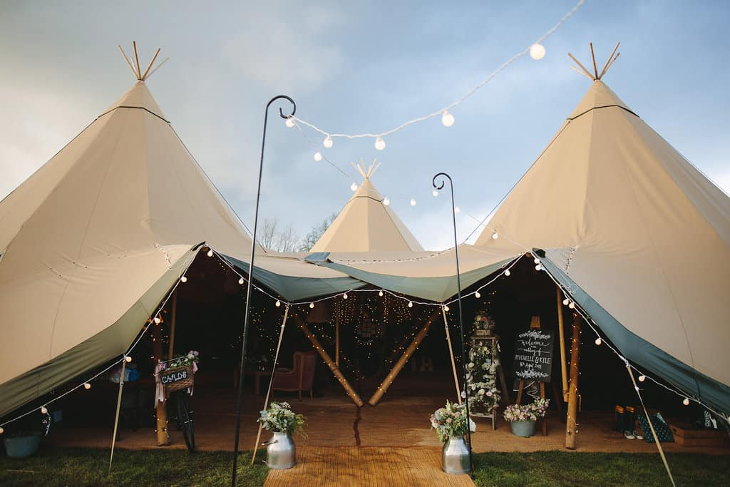 three giant hat tipis - Sami Tipi Wedding by london-weddingphotographer