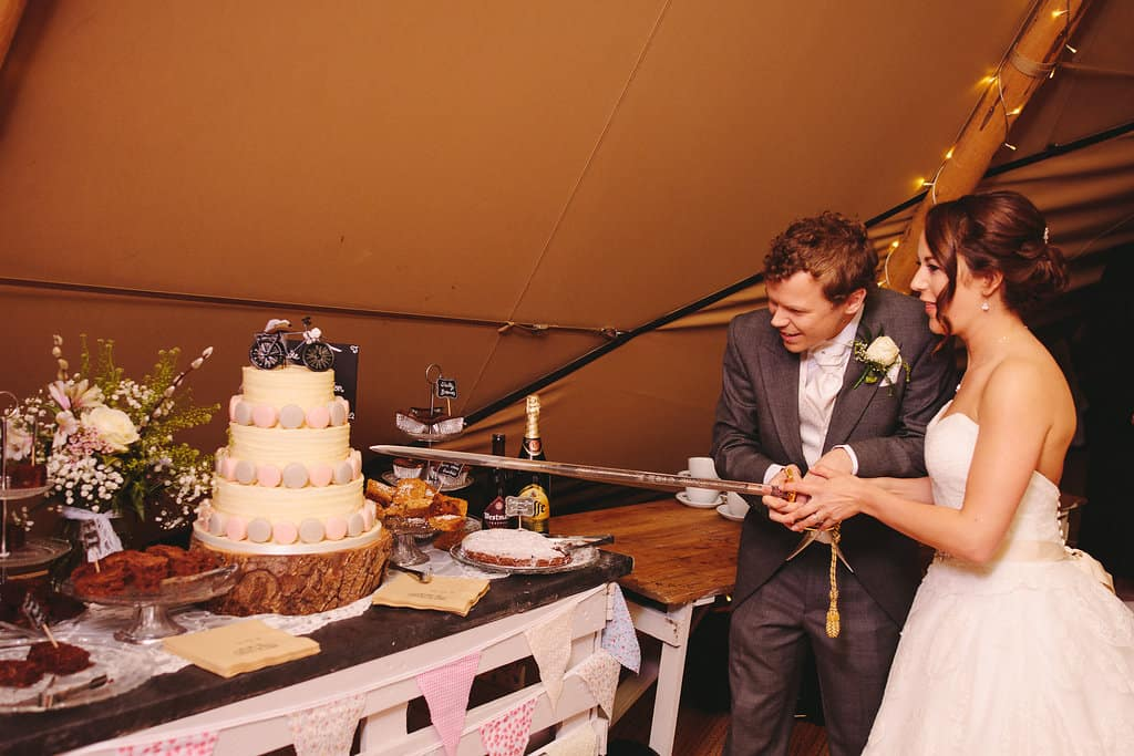 cake cutting - Sami Tipi Wedding by london-weddingphotographer
